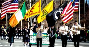 Morristown, New Jersey, USA - March 9, 2013: Formation leaders carry flags at the Saint Patrick's Day festival
