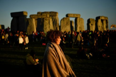 Crowds attend summer solstice celebrations at the ancient Stonehenge monument in Wiltshire, England. Photograph: Neil Hall/EPA