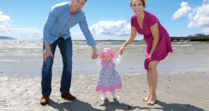 Séamus and Hazel Hughes with their daughter, Saorla, on the beach near their home in Barna, Co Galway. Photograph: Joe O'Shaughnessy