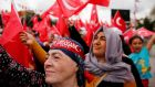 Supporters of president Tayyip Erdogan wave Turkish flags in Istanbul. The country's  international relations are  changing. Photograph: Murad Sezer