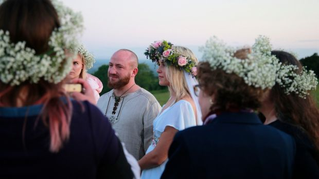 Jeff Olsen and Anna Lisa Van Bloem from Utah celebrate their marriage on the Hill of Tara. Photograph Nick Bradshaw/The Irish Times