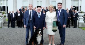 President Michael D Higgins, with one of his dogs, and his wife, Sabina,   with Pat  and  Michael English at the Presidential Concert, celebrating Irish country music in Áras an Uachtaráin.