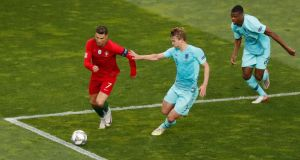 Matthijs de Ligt in action for the Netherlands against Portugal's Cristiano Ronaldo in the Nations League Final at Estadio do Dragao in Porto. Photograph: Susana Vera/Reuters
