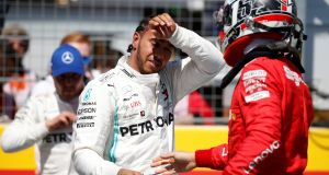 Mercedes' Lewis Hamilton celebrates pole after qualifying with  Ferrari's Charles Leclerc at the  French Grand Prix at Circuit Paul Ricard. Photograph:  Vincent Kessler/Reuters