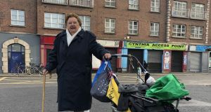 Tessie Carroll brings her pram of clothes and bric-a-brac to 'the Tuggers' market for the last time on Saturday.