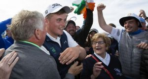 Mallow's James Sugrue  celebrates victory in the British Amateur Championship  at Portmarnock Golf Club. Photograph:  Patrick Bolger/Getty Images