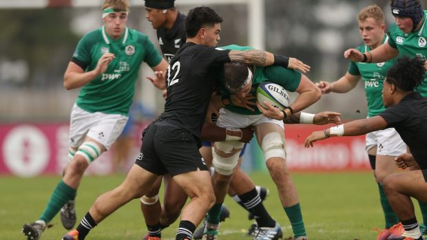 Ireland's Thomas Ahern is tackled by Billy Proctor of New Zealand during the World Rugby U20 Championship seventh-place playoff in Rosario. Photograph: Pablo Gasparini/Inpho