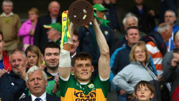 Kerry's captain Gavin White lifts the trophy after winning the Munster football championhsip. Photograph: James Crombie/Inpho