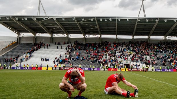 Cork's Sean White and Mattie Taylor after the final whistle. Photograph: James Crombie/Inpho