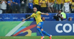 Man of the match Everton celebrates his goal in Brazil's 5-0 rout of Peru. Photograph: Alexandre Schneider/Getty
