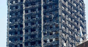 The burned-out shell of the Grenfell Tower block is seen near the scene of the fire in North Kensington, west London on June 20, 2017. Photograph: Getty Images