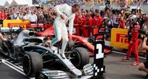 Lewis Hamilton celebrates his victory in the French Grand Prix. Photograph: Jean-Paul Pelissier/Reuters