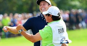 Andrea Pavan of Italy celebrates with his caddie on the 18th green after his victory during a playoff with Matt Fitzpatrick to win the  BMW International Open at Golfclub Munchen Eichenried in Munich, Germany. Photograph: Stuart Franklin/Getty Images
