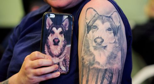 Sabrina Horan from North Dublin Cat Rescue with a tattoo of Tyson, a Nikita Shepard dog,  during the first-ever pet remembrance ceremony in the Unitarian Church in Dublin. Photograph: Gareth Chaney/Collins