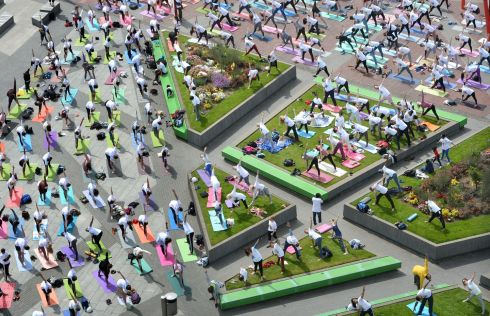 Crowds taking part in International Day of Yoga, on Grand Canal Square in Dublin, in an event organised by the Indian Embassy and Dublin City Council. Photograph: Dara Mac Donaill/The Irish Times