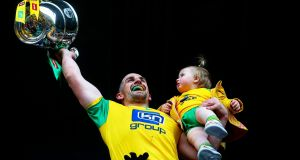 Donegal's Paddy McGrath lifts the Anglo-Celtic Cup with his daughter Isla Rose after beating Cavan in the Ulster Football Championship final in St Tiernach's Park, Clones, Co. Monaghan. Photograph:  Tommy Dickson/Inpho