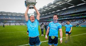 Dublin's Brian Howard holding aloft the  Delaney Cup after victory over Meath in the Leinster Championship final in Croke Park. Photograph: Ryan Byrne/Inpho