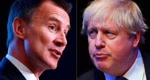 "Jeremy Hunt (L) has previously attacked Boris Johnson over reports he was ""bottling"" a live TV debate before postal ballots are returned. Photograph: Odd Andersen/Paul Ellis/AFP/Getty"
