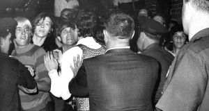 People attempt to prevent police arrests outside the Stonewall Inn, on Christopher Street,  Greenwich Village, New York on Jubne 28th, 1969. Photograph:  NY Daily News Archive/Getty Images