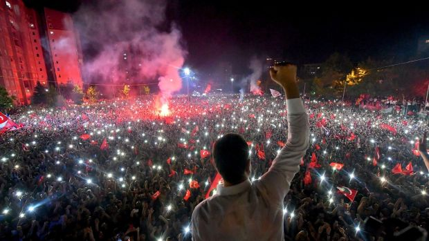 Republican People's Party (CHP) candidate for mayor of Istanbul Ekrem Imamoglu celebrating in front of supporters at Beylikduzu in the city after his decisive win in Sunday's election. Photograph: CHP press service/AFP/Getty Images