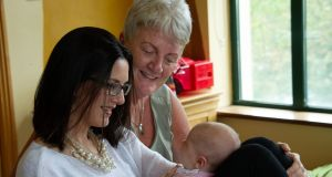 Emma Brodbin and her baby girl Nadia with Community Mother Margaret Waters at Clonmel Community Resource Centre, Co Tipperary.