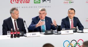 International Olympic Committee  president Thomas Bach (centre)   with Coca-Cola president and CEO James Quincey and China Mengniu Dairy CEO and executive director Jeffrey Lu  in Lausanne, Switzerland, on Tuesday.  Photograph: Laurent Gillieron/EPA