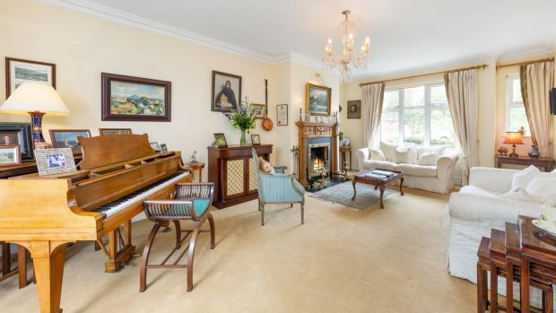The house opens into a large L-shaped hall and flows around it with the drawing room to the right, a dual aspect space big enough to accommodate a baby grand piano.