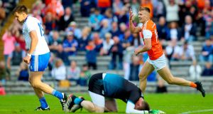 Armagh's Rian O'Neill celbrates scoring a goal against Monaghan in the All-Ireland round two qualifier at Clones.  Photograph: Tommy Dickson/Inpho