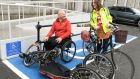 Mark Nugent, a hand-operated tricycle user, and Clodagh Colleran, a member of of the Healthy Trinity: Smarter Travel Committee, at Trinity College Dublin. Photograph: Dara Mac Donaill