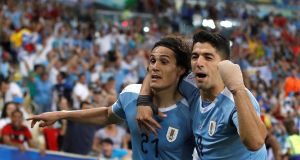 Edinson Cavani and Luis Suarez celebrate their Copa America win over Chile in Rio de Janeiro last night. Photograph: EPA