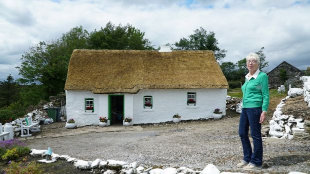 Margaret Gallagher lives in a 280-year-old Grade A listed thatch cottage in Co Fermanagh with no running water or electricity. Photograph: Enda O'Dowd/The Irish Times