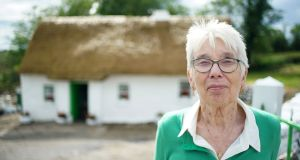 "Margaret Gallagher outside her Grade A-listed thatched cottage in Co Fermanagh: ""I'll continue as long as I'm able and have the health and will to do it."" Photograph: Enda O'Dowd/Irish Times"