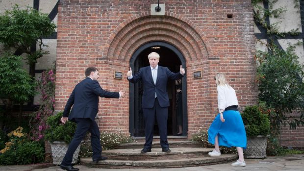 Conservative party leadership candidate Boris Johnson gestures to visitors as two of his staff ascend steps during a tour of the Royal Horticultural Society garden at Wisley, in Surrey. Photograph: Stefan Rousseau/PA Wire