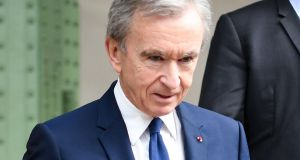 Bernard Arnault: Even the man who owns Christian Dior, Louis Vuitton, Dom Pérignon, and other luxury brands must have gone to school post-natally like the rest of us. Photograph:  Christophe Archambault / AFP /Getty Images