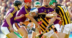 Wexford's  Paul Morris and Lee Chin tackle Kilkenny's Huw Lawlor  during the drawn Leinster championship clash at Wexford Park. Photograph: James Crombie/Inpho