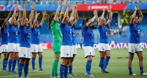 The Italy players celebrate after the match. Photograph: Jean-Paul Pelissier/Reuters