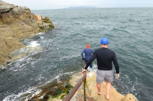 DUBLIN BAY DIP: Barry Delaney of Dún Laoghaire and Neil Horgan of Stepaside, about to go for a swim at the Forty Foot in Dublin on Tuesday, where there is a swimming ban in place following an overflow of waste water. Photograph: Dara Mac Donaill