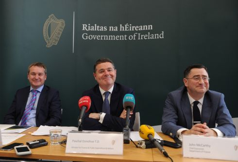HOLDING THE PURSE STRINGS: Minister for Finance Paschal Donohoe (centre) with Robert Watt, secretary-general of the Department of Public Expenditure and Reform (left), and John McCarthy, chief economist at the Department of Finance, at the announcement of the Government's Summer Economic Statement. Photograph: Aidan Crawley