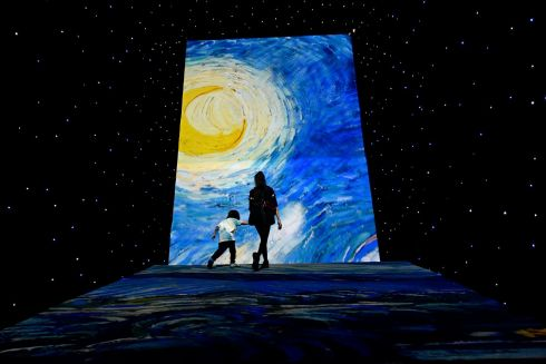 IMMERSIVE EXPERIENCE: Visitors take in a large projection during an immersive exhibition on artist Vincent van Gogh in Beijing. Photograph: Wang Zhao/AFP/Getty