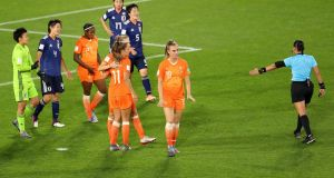 Referee Melissa Borjas awards the Netherlands a late penalty against japan. Photograph:  Maja Hitij/Getty Images