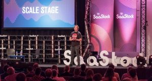 SaaStock founder Alex Theuma on stage at last year's event