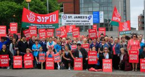 Health support are pictured during their 24-hour  strike outside St James's Hosptial in Dublin. Photograph: Gareth Chaney/Collins.