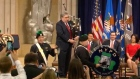 US attorney general joins NYPD's Emerald Society in surprise bagpipe performance
