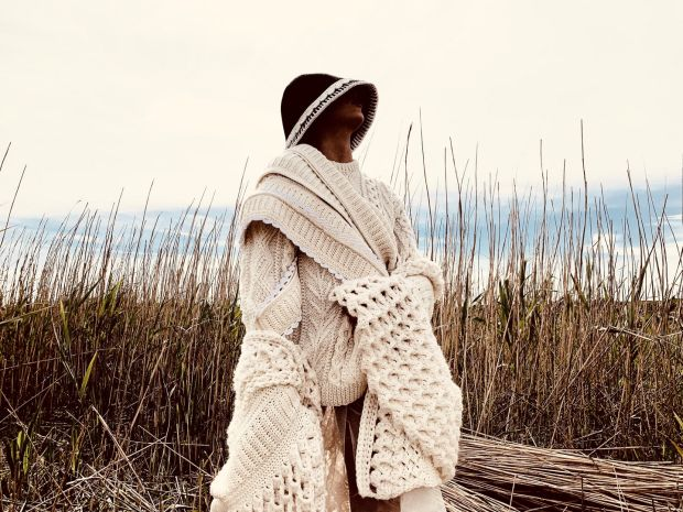 Hand-crochet coat with rib and wave stitch, hand-knitted Aran jumper with hand-crochet trim in ivory Donegal yarn, €1,295.