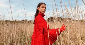 Oversize hand-crochet wave stitch red sweater with caped sleeves by Colin Burke, €1,295.