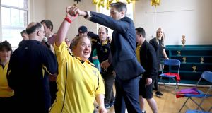 MOVERS AND LAKERS: Members of the Lakers, a social, recreational and sports club for people with intellectual disabilities, celebrate after the opening of their new facility in Bray, Co Wicklow. Mandy Finlay (above), takes a twirl with Minister for Health Simon Harris. A fire had destroyed their original premises in October 2018. Photograph: Maxwellphotography.ie