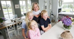 Interior designer Emma Kelly with her family at home  in Kinsale, Co Cork. Photograph:  Daragh Mc Sweeney/Provision