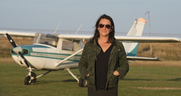 Hannah Quinn photographed at Newcastle Aerodrome, with a Cessna 150. Photograph: Dave Meehan