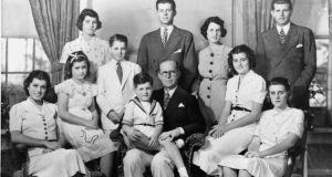 Joseph P. Kennedy and his wife Rosemary Kennedy pose with their nine children for this picture in 1938 at Bronxville. From left are, seated: Eunice, Jean, Edward (on lap of his father), Patricia, and Kathleen. Standing: Rosemary, Robert, John, Mrs Kennedy, and Joseph, Jr. Photograph: Boston Globe/AP Photo