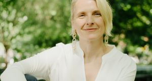 Elizabeth Gilbert: frothy delight delivers a real kick beneath the bubbles. Photograph: Heather Sten/The New York Times